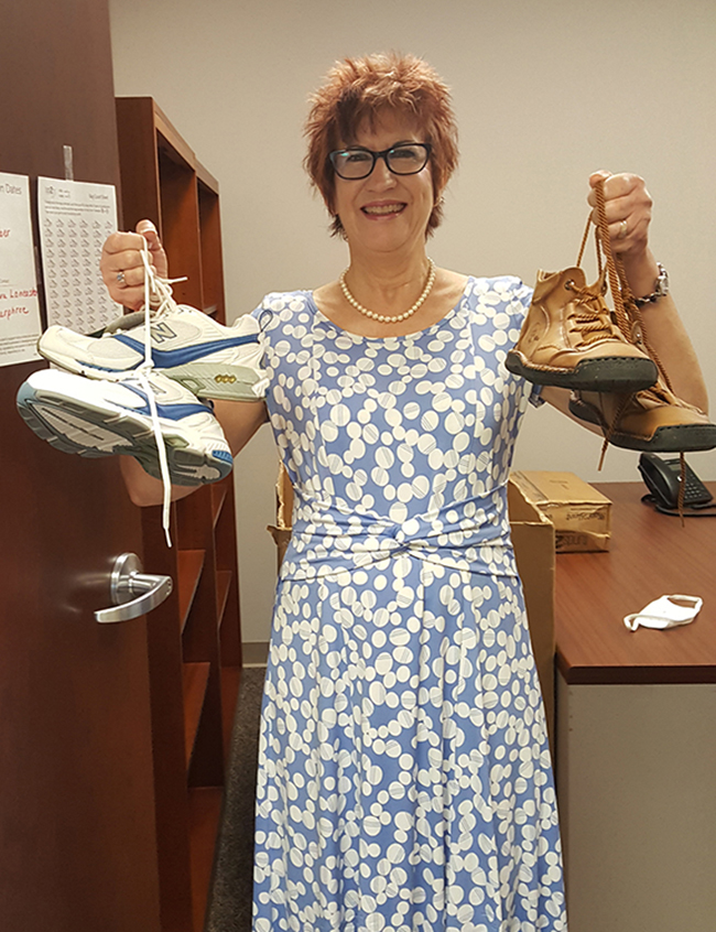Dr. Barbara Lancaster, an assistant professor of nursing, holds some shoes donated as part of a drive to collect shoes for people in developing nations. Money based on the weight of the shoes and provided by Fund2Org will be donated to the American Heart Association. (Photo submitted)