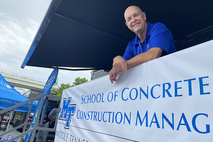 Kelly Strong, director of the MTSU School of Concrete and Construction Management enjoys the sights and sounds Friday, Aug. 6, 2021, from MTSU's hospitality area on the grounds of the Big Machine Music City Grand Prix in Nashville, Tenn. MTSU concrete students helped research and test an environmentally friendly concrete mixture for both a barrier wall and pit lane for the race. (MTSU photo by Andrew Oppmann)