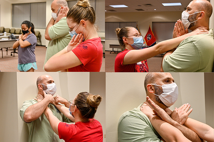 Middle Tennessee State University Training Sgt. Jason Hurley explains how to defend against a choke hold with MTSU Police Officer Katelynn Erskine during the first night of the free self-defense course Rape Aggression Defense Systems, or RAD, on Sept. 7, 2021. (MTSU photo by Stephanie Barrette)
