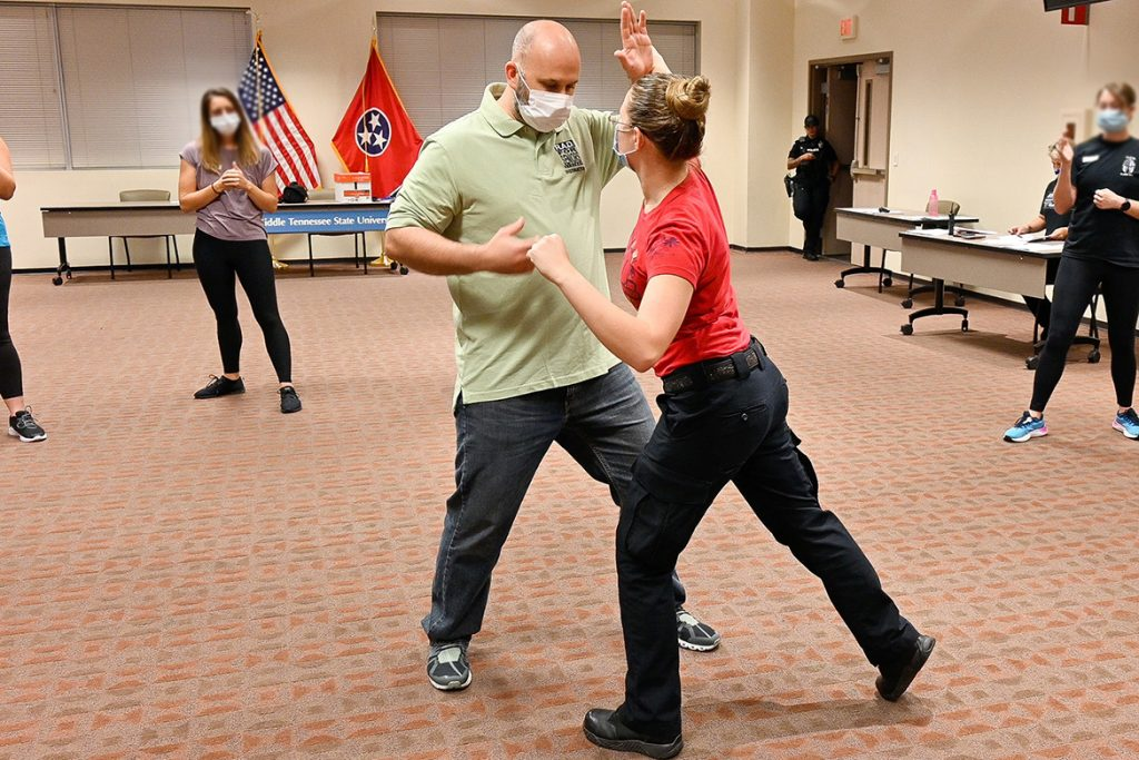 Jason Hurley, Middle Tennessee State University training sergeant, models deflecting an attack with Katelynn Erskine, MTSU police officer, as part of the self-defense course Rape Aggression Defense Systems, or RAD, offered free of charge on Sept. 7, 2021. (MTSU photo by Stephanie Barrette)
