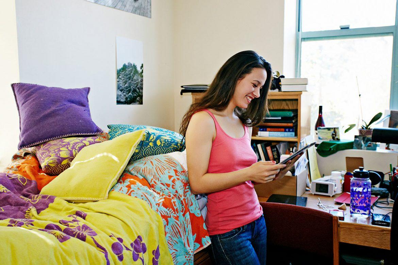 Stock photo of woman in dorm room