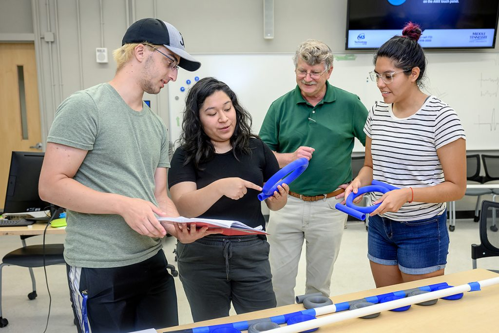 Middle Tennessee State University hosted undergraduate students from around the country who earned the National Science Foundation Research Experience for Undergraduates grant. Standing from left are Alex LaVerde, Carina Vazquez, William Robertson, MTSU physics and astronomy professor, and Jennifer Lopez who worked on math-based research like this acoustic ring resonance project on July 28, 2021, in the Wiser-Patten Science building. (MTSU photo by J. Intintoli)
