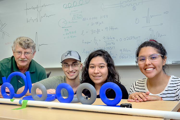 William Robertson, Middle Tennessee State University physics and astronomy professor, far left, worked with undergraduate students from around the country as part of the National Science Foundation Research Experience for Undergraduates grant. Students, kneeling from left, Alex LaVerde, Carina Vazquez and Jennifer Lopez researched acoustic ring resonance in the Wiser-Patten Science building on July 28, 2021. (MTSU photo by J. Intintoli)