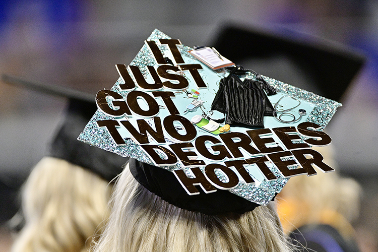A new MTSU graduate's customized mortarboard celebrates her accomplishment at the university's summer 2021 commencement ceremony Saturday, Aug. 7, in Murphy Center. MTSU presented degrees to 825 new graduates of the August Class of 2021 at the event. (MTSU photo by Andy Heidt)