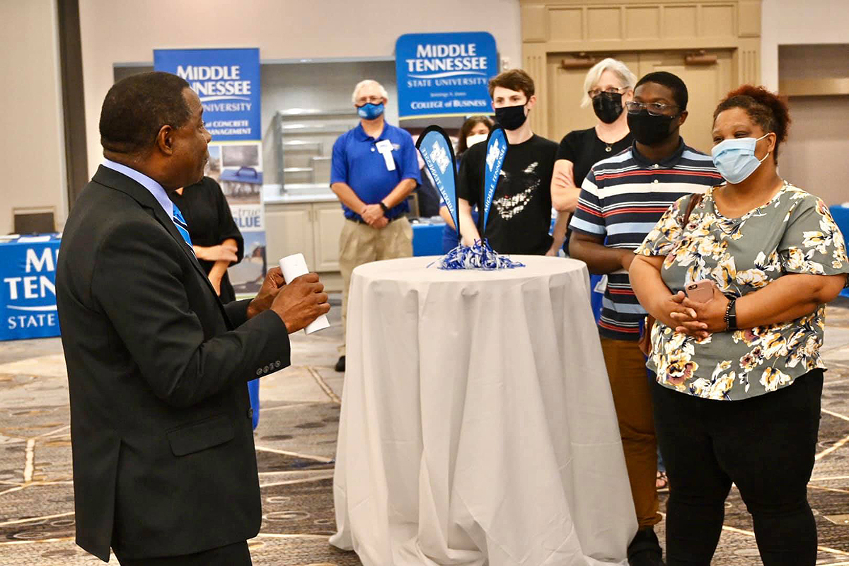 MTSU President Sidney A. McPhee, left, visits with prospective students and their parents attending the True Blue Tour event at the Marriott Birmingham in Hoover, Ala., Tuesday, Sept. 21. Listening are Jennifer Davis, right, her son Christian Davis, of Hoover, and Leigh Ann Harris and her son, Nathan Harris, of Chelsea, Ala. McPhee awarded Davis, Harris, Kyla Fulton of Pelham, Ala., and Jordan Gunter of Vestavia Hills, Ala., $2,000 scholarships. (MTSU photo by Andrew Oppmann)