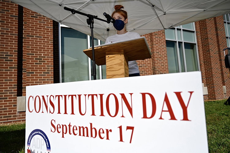 A student reads a portion of the U.S. Constitution at the Academic Classroom Building Sept. 16 during MTSU's Constitution Week celebration. (MTSU photo by J. Intintoli)
