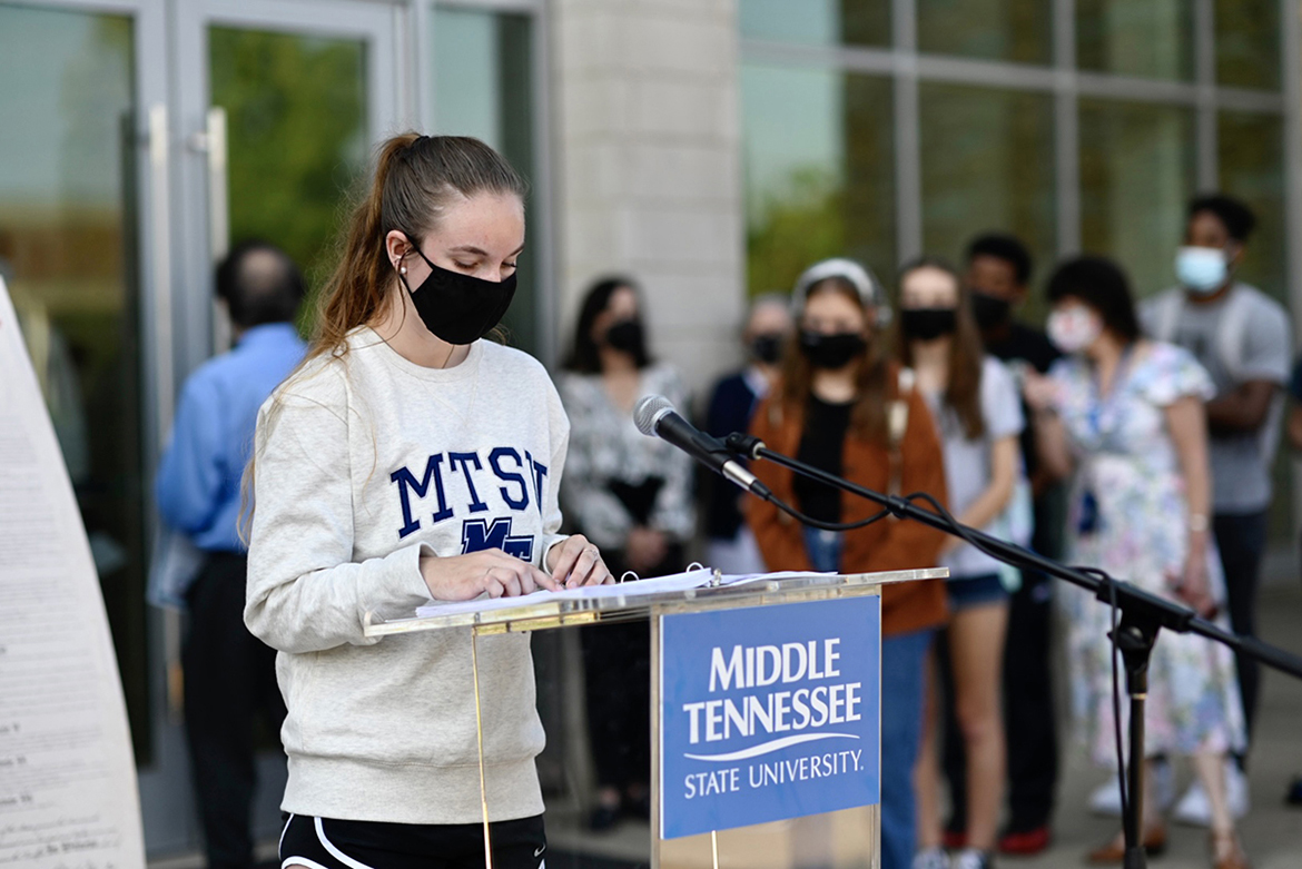 A student reads a section of the U.S. Constitution outside the MTSU Science Building Sept. 14 as part of the university's celebration of Constitution Week. (MTSU photo by J. Intintoli)