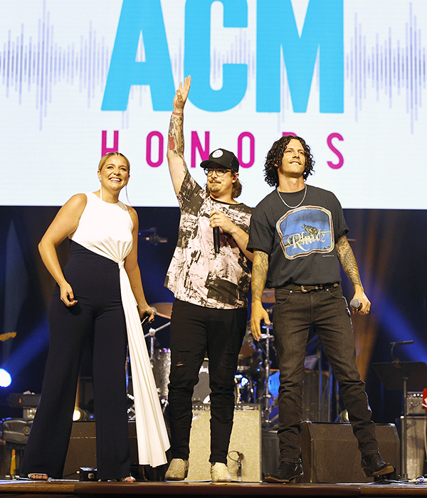 """MTSU Department of Recording Industry alumnus Hardy, center, raises his hand to recognize his co-writer, Hillary Lindsey, after performing their platinum-selling """"One Beer"""" with guests Lauren Alaina, left, and Devin Dawson Aug. 25 Aug. 25 at the 14th annual ACM Honors at the Ryman Auditorium in Nashville. Both Lindsey and Hardy were nominated as the Academy of Country Music's songwriter of the year. The show will be broadcast on Circle TV on Tuesday, Nov. 23, at 7 p.m. Central with an encore presentation at 11 p.m. Central. (photo by Jason Kempin/Getty Images for Academy of Country Music)"""