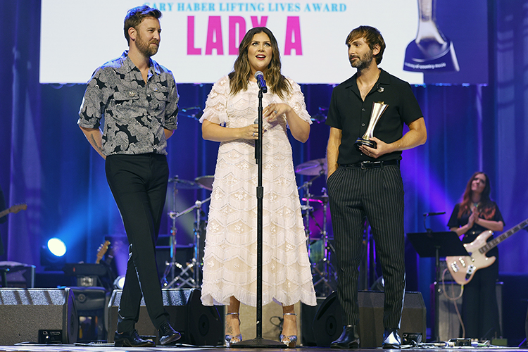 Former MTSU student and scholarship creator Hillary Scott, center, speaks while her bandmates in Lady A, Charles Kelley, left, and Dave Haywood listen while they accept the Academy of Country Music's Gary Haber Lifting Lives Award for their philanthropic work at the Aug. 25 ceremony for the 14th annual ACM Honors at the Ryman Auditorium in Nashville. The show will be broadcast on Circle TV on Tuesday, Nov. 23, at 7 p.m. Central with an encore presentation at 11 p.m. Central. (photo by Jason Kempin/Getty Images for Academy of Country Music)