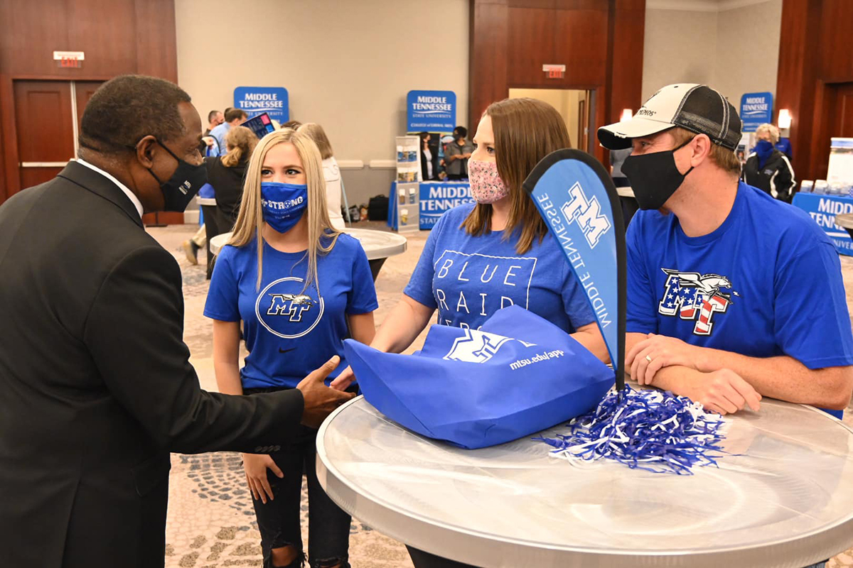 MTSU President Sidney A. McPhee meets with a prospective student and her family attending the True Blue Tour recruiting event Sept. 22 at The Westin Huntsville hotel in Huntsville, Ala. It completed a two-day visit to Alabama. MTSU's tour events, which are free, cover four states and 14 cities. (MTSU photo by Andrew Oppmann)