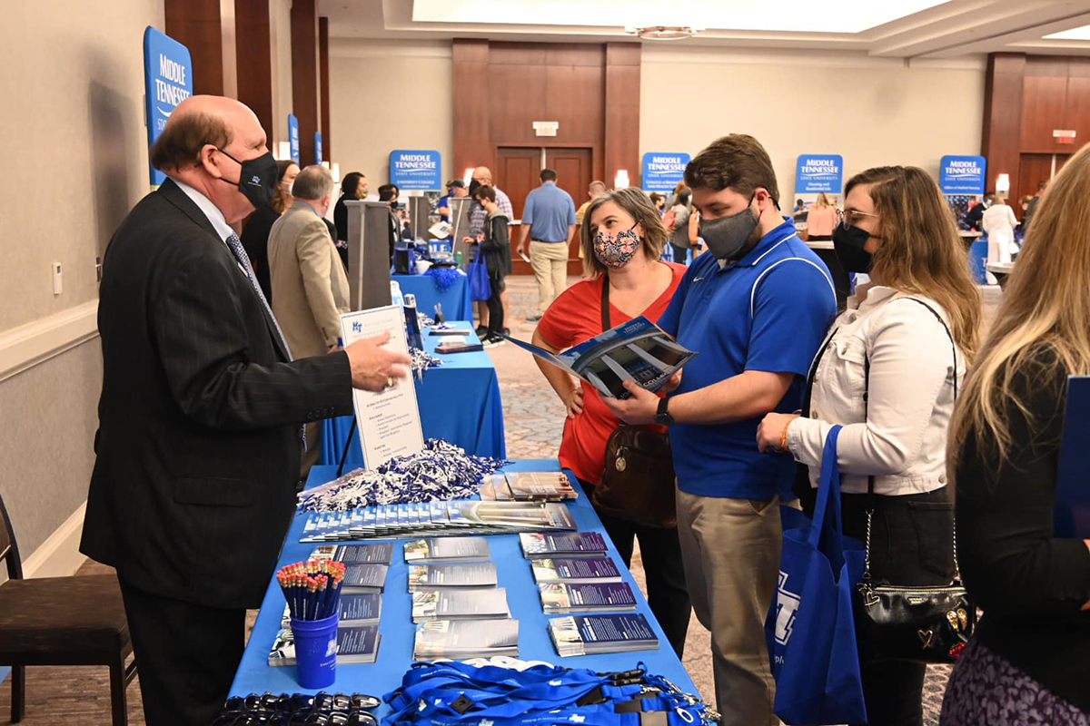 MTSU Jones College of Business Dean David Urban, left, provides helpful information to prospective students and their family members Wednesday, Sept. 22, at the True Blue Tour event at The Westin Huntsville in Huntsville, Ala. Students from area high schools attended the event, which featured scholarship giveaways, a video about campus and information about housing, financial aid and academic programs. (MTSU photo by Andrew Oppmann)