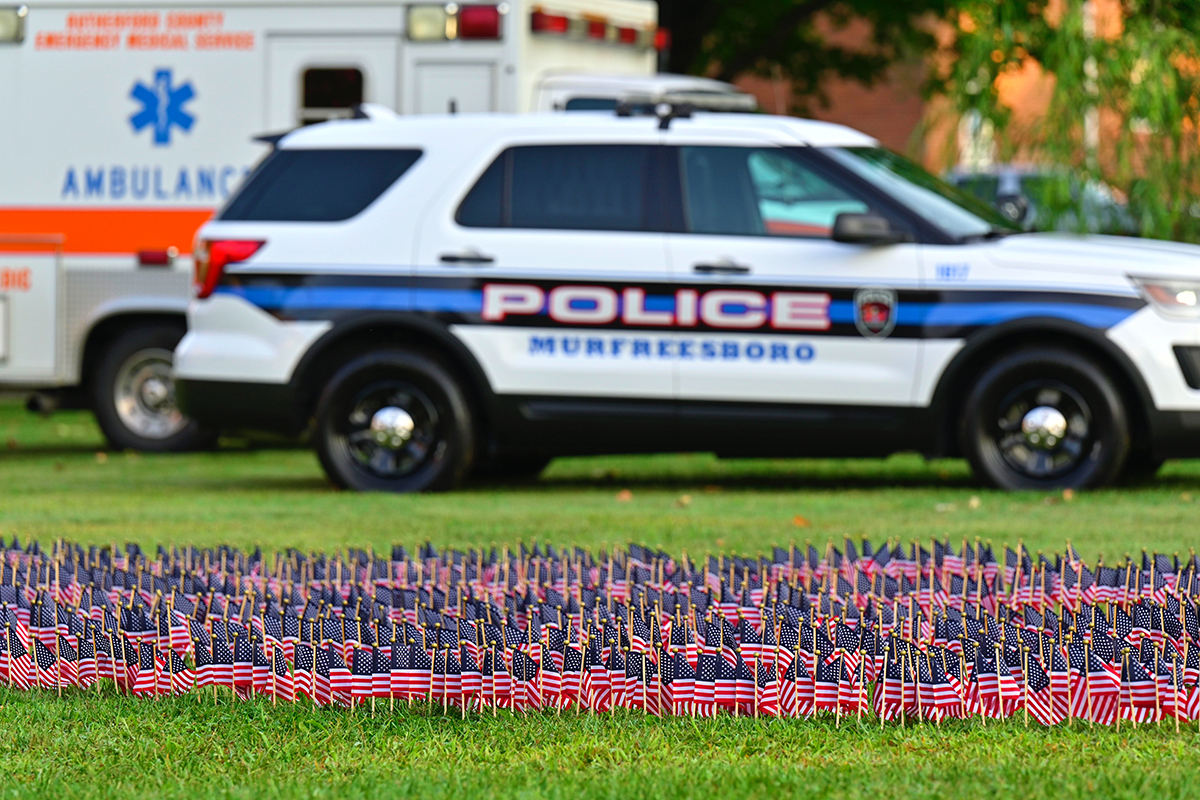 Along with a field of U.S. flags representing the 2,977 casualties from the 9/11 attacks on Sept. 11, 2001, static displays of first responder vehicles (Murfreesboro City Police and Fire and Rutherford County EMS) were part of the 7th 9/11 Remembrance Saturday, Sept. 11, near the MTSU Veterans Memorial. (MTSU photo by Cat Curtis Murphy)