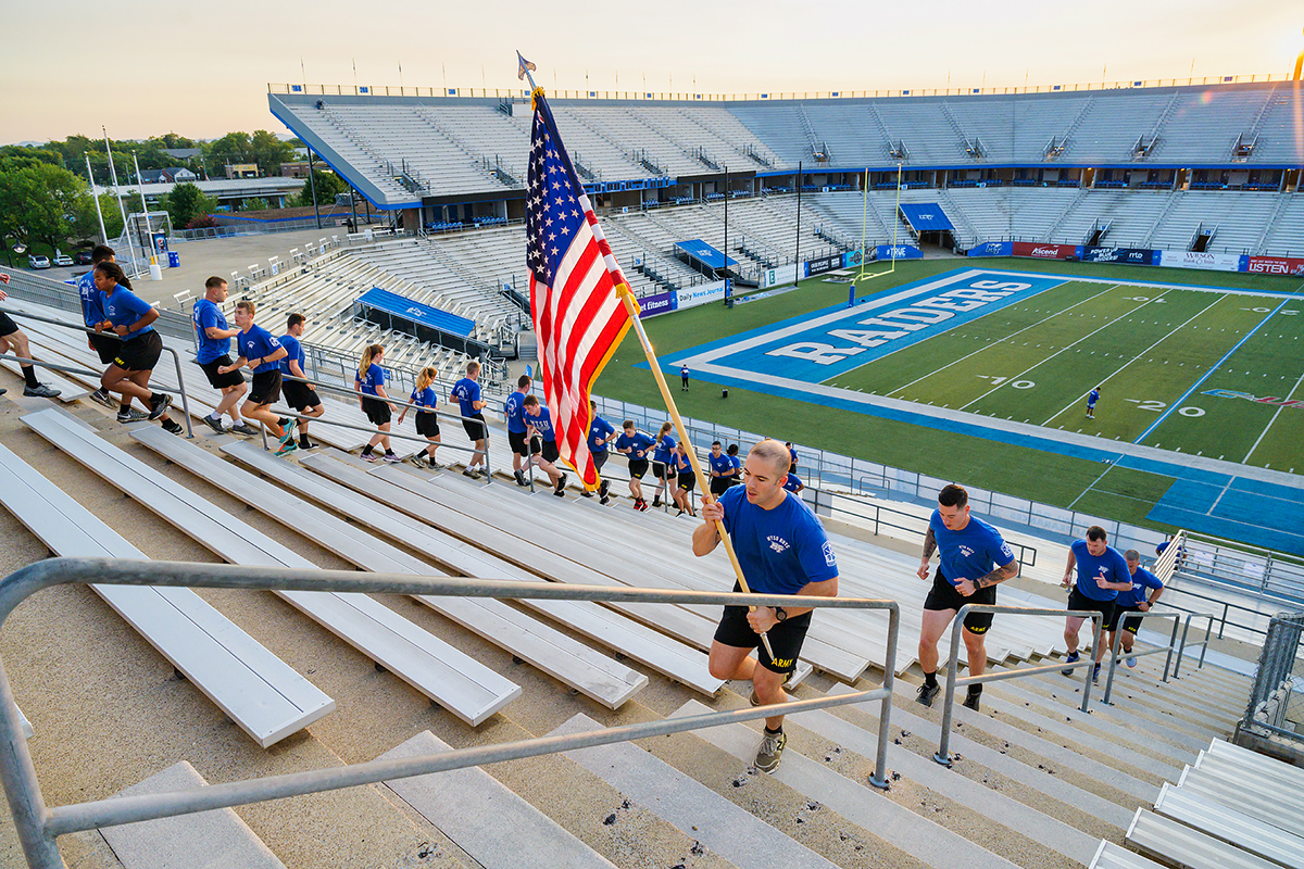 Led by MTSU ROTC cadet flag bearer Joshua Muller, cadet Michael Maynard, Military Science Department leader Carrick McCarthy, Maj. Ben Sweeney and the other cadets and faculty run the steps in Floyd Stadium Friday, Sept. 10, in remembrance of fallen 9/11 first responders who died Sept. 11, 2001. Maynard led the cadet corps in a series of early-morning activities to commemorate the 20th anniversary of the tradegy. (MTSU photo by Andy Heidt)
