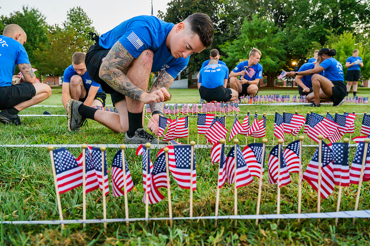 MTSU senior ROTC cadet Michael Maynard of Pleasant View, Tenn., and nearly 60 cadets, student veterans, SGA officers and others place nearly 3,000 small U.S. flags in the ground to commemorate the 20th anniversary of 9/11 on Friday, Sept. 10, near the Veterans Memorial outside the Tom H. Jackson Building on campus. (MTSU photo by Andy Heidt)