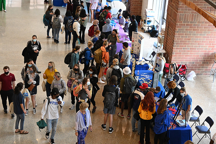 MTSU students mingle among the informational booths of a variety of organizations participating in the Mental Wellness and Suicide Prevention Fair held Wednesday, Sept. 22, in the Student Union atrium. Information and resources were available for suicide prevention, stress relief, and coping strategies, with activities including rock painting, Mental Health Jeopardy, make-your-own stress ball, meditation booth and more. (MTSU photo by Leah Chollman)
