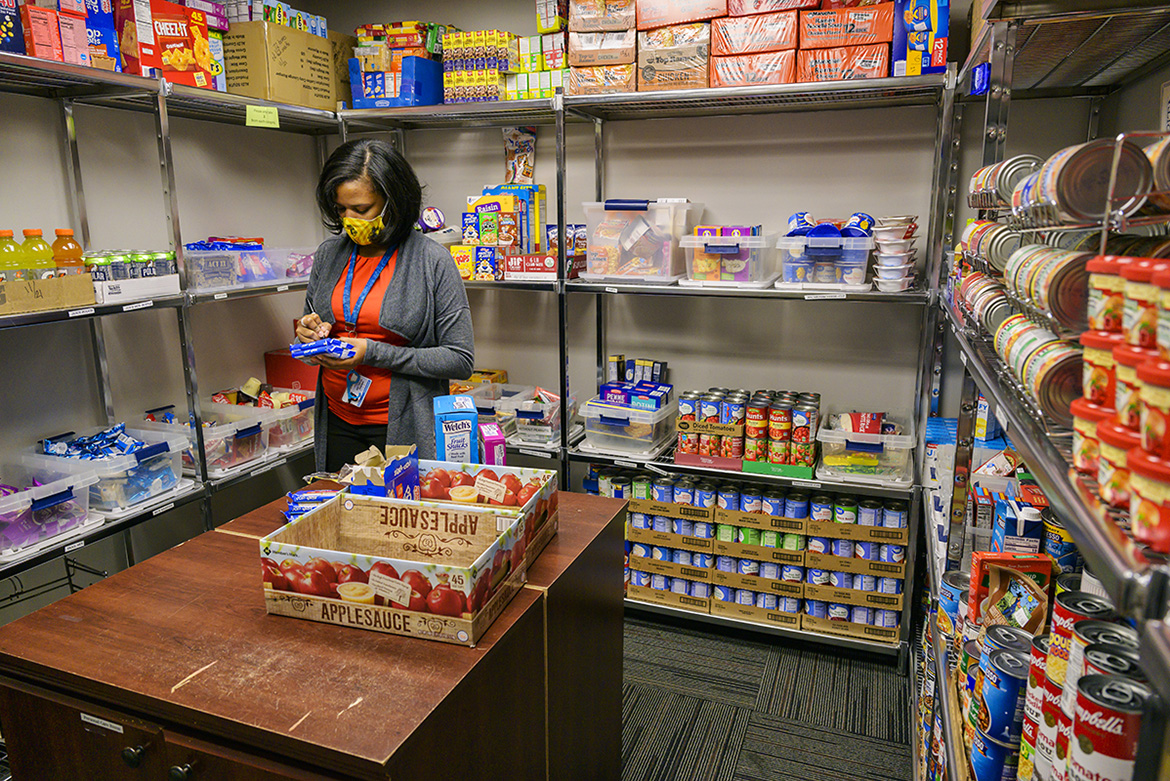 Danielle Rochelle, coordinator of outreach and support programs, checks the inventory in the MTSU Student Food Pantry in the MT One Stop. (MTSU photo by Andy Heidt)