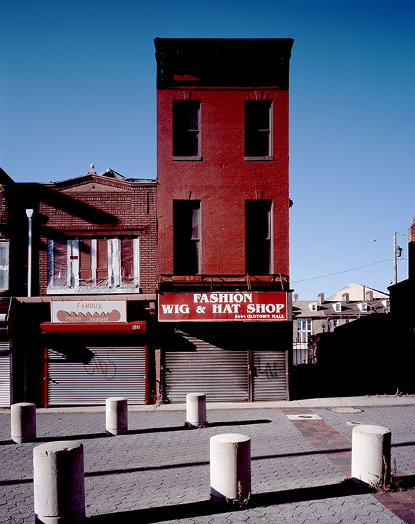 """This 2009 image of the historic two- and three-story brick buildings at 544 Old Town Mall in Baltimore, Md., is part of photographer and archivist James Singewald's exhibit at MTSU's Baldwin Photo Gallery, """"Baltimore: Block by Block, Work in Progress …,"""" open Sept. 16-Oct. 28. Singewald began photographing the failed 1920s urban renewal project in East Baltimore known as Old Town Mall 13 years ago, when he was a graduate student at the Maryland Institute College of Art, to try to create a """"historical document of what is left of the neighborhood after decades of decline."""" (photo courtesy of James Singewald)"""