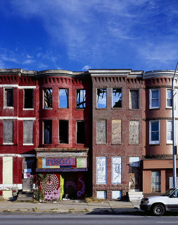 """This 2014 image of the historic three-story brick buildings at 1390 and 1388 W. North Ave. in Baltimore, Md., is part of photographer and archivist James Singewald's exhibit at MTSU's Baldwin Photo Gallery, """"Baltimore: Block by Block, Work in Progress …,"""" open Sept. 16-Oct. 28. Singewald began photographing the failed 1920s urban renewal project in East Baltimore known as Old Town Mall 13 years ago, when he was a graduate student at the Maryland Institute College of Art, to try to create a """"historical document of what is left of the neighborhood after decades of decline."""" (photo courtesy of James Singewald)"""