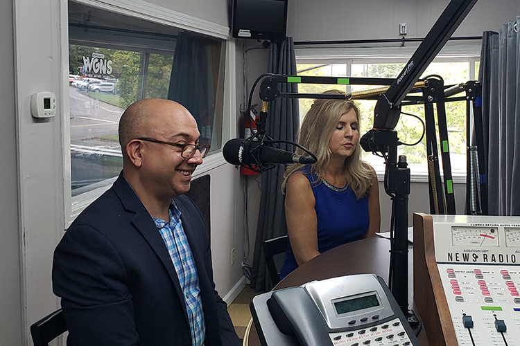 """Cynthia Chafin, right, associate director of community programs for the MTSU Center for Health and Human Services, and Michael Ayalon, Rural Communities Opioid Response Program coordinator, discuss a new federal grant to combat opioid abuse in Wilson County on the Monday, Sept. 20, WGNS """"Action Line"""" program with host Scott Walker. (MTSU photo by Jimmy Hart)"""