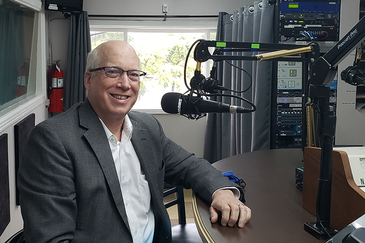 """Dr. Ken Currie, chair of the Engineering Technology Department, prepares to go on air for the Monday, Sept. 20, WGNS """"Action Line"""" program with host Scott Walker. (MTSU photo by Jimmy Hart)"""
