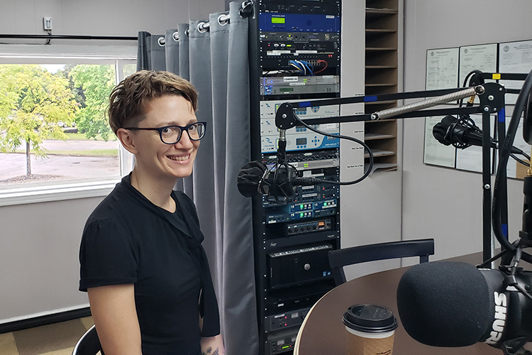 """Amie Whittemore, English lecturer, new MTSU Write direcor and Murfreesboro Poet Laureate, prepares to go on air for the Monday, Sept. 20, WGNS """"Action Line"""" program with host Scott Walker. (MTSU photo by Jimmy Hart)"""