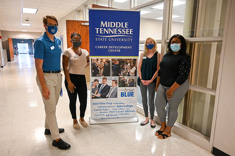 Ikeia Gaines, far right, recent Middle Tennessee State University master's graduate in criminal justice administration, used the university's Career Development Center to obtain her full-time probation officer position in Marshall County, Tennessee. She continues to use the center's services and visited the on-campus center and staff on Sept. 8, 2021. (MTSU photo by Stephanie Barrette)