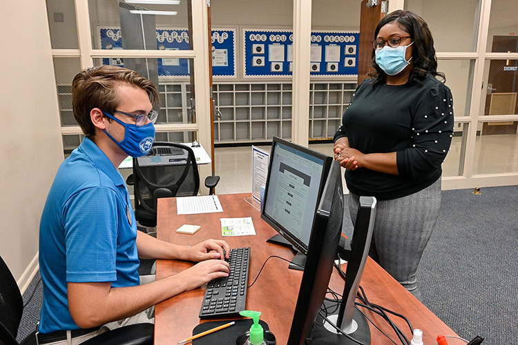 Ikeia Gaines, right, recent Middle Tennessee State University master's graduate, gets help from Jason Wasilewski, MTSU peer career ambassador, at the university's Career Development Center on Sept. 8, 2021. The center helped Gaines obtain her full-time probation officer position in Marshall County, Tennessee. (MTSU photo by Stephanie Barrette)