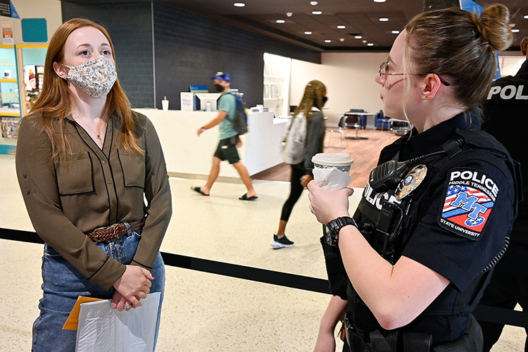 Middle Tennessee State University Officer Katelynn Erskine, right, talks with Amy Roberts, secretary at MTSU's TRiO Student Support Services, at the Police's Coffee with a Cop event on campus on Sept. 29, 2021. (MTSU photo by Stephanie Barrette)