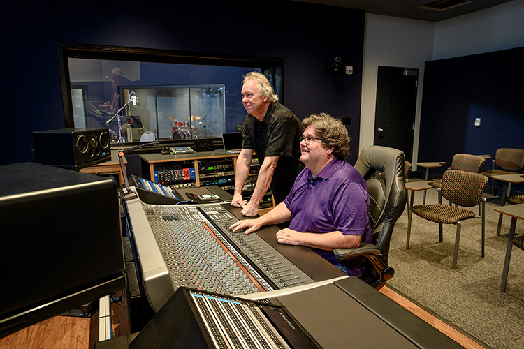 Professors Bill Crabtree, seated, and Dan Pfeifer of the Department of Recording Industry at Middle Tennessee State University work at the mixing console in the control room of Studio D, one of the department's two newly relocated, customized, expandable recording facilities for students in the East Main Building on campus. Crabtree, who directs the department's Master of Fine Arts in Recording Arts and Technologies degree program, and Pfeifer are the co-chairs of a committee overseeing the nearly $2 million studio project, which covers almost 5,000 square feet of recording space, control rooms, equipment rooms and an open gathering/reception area. (MTSU photo by J. Intintoli)