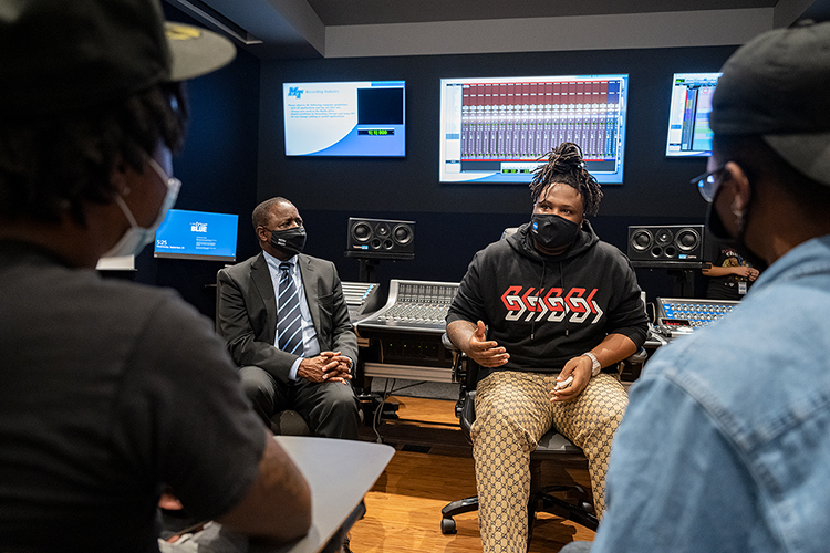 """Memphis native and Grammy-nominated hip-hop producer BryTavious """"Tay Keith"""" Chambers, center, answers questions from Middle Tennessee State University students Wednesday, Sept. 29, during Chambers' special """"sneak-peek"""" visit to his alma mater for a tour of the MTSU Department of Recording Industry's new studios on campus. At left is MTSU President Sidney A. McPhee. (MTSU photo by Cat Curtis Murphy)"""
