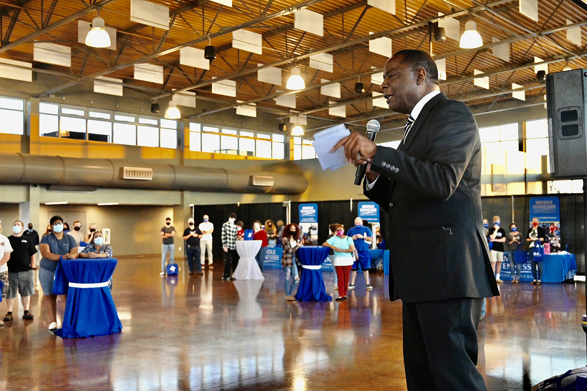 MTSU President Sidney A. McPhee talks to the Clarksville, Tenn., audience attending the True Blue Tour recruiting event held Tuesday, Sept. 28, at the Wilma Rudolph Event Center. He discussed academic programs including audio production and accounting, and invited prospective students and their families to come and visit the Murfreesboro campus. (MTSU photo by Andrew Oppmann)