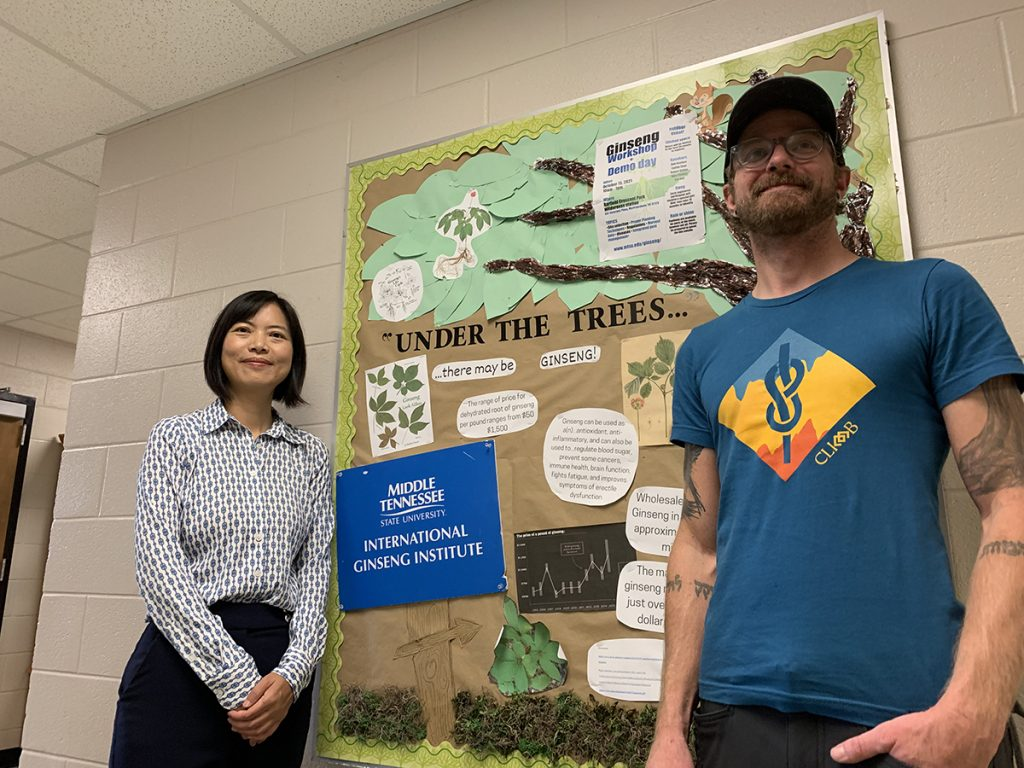 Dr. Iris Gao, left, director of the International Ginseng Institute at MTSU, receives research help from laboratory technician Ethan Swiggart in the lab located in the Stark Agriculture Building. The institute has received $747,500 in funding — $455,000 from the USDA's National Institute of Food and Agriculture to continue ginseng research. Partners will include Penn State University, the University of Tennessee-Knoxville, the University of Virginia College at Wise and North Carolina State University. (MTSU photo by Randy Weiler)
