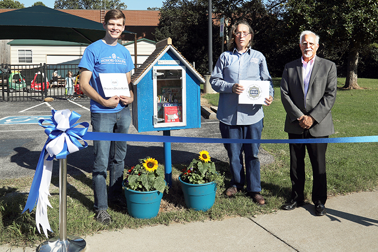 Members of Phi Kappa Phi and Omicron Delta Kappa honor societies celebrated the opening of the first Little Free Library at the Ann Campbell Early Learning Center on the MTSU campus Sept. 27. Pictured, from left, are ODK Chapter President Liam McBane, PKP Student Vice President Nathan Wahl, and PKP Vice President and President-elect David Foote, professor in the Jennings A. Jones College of Business. (MTSU photo by Marsha Powers)