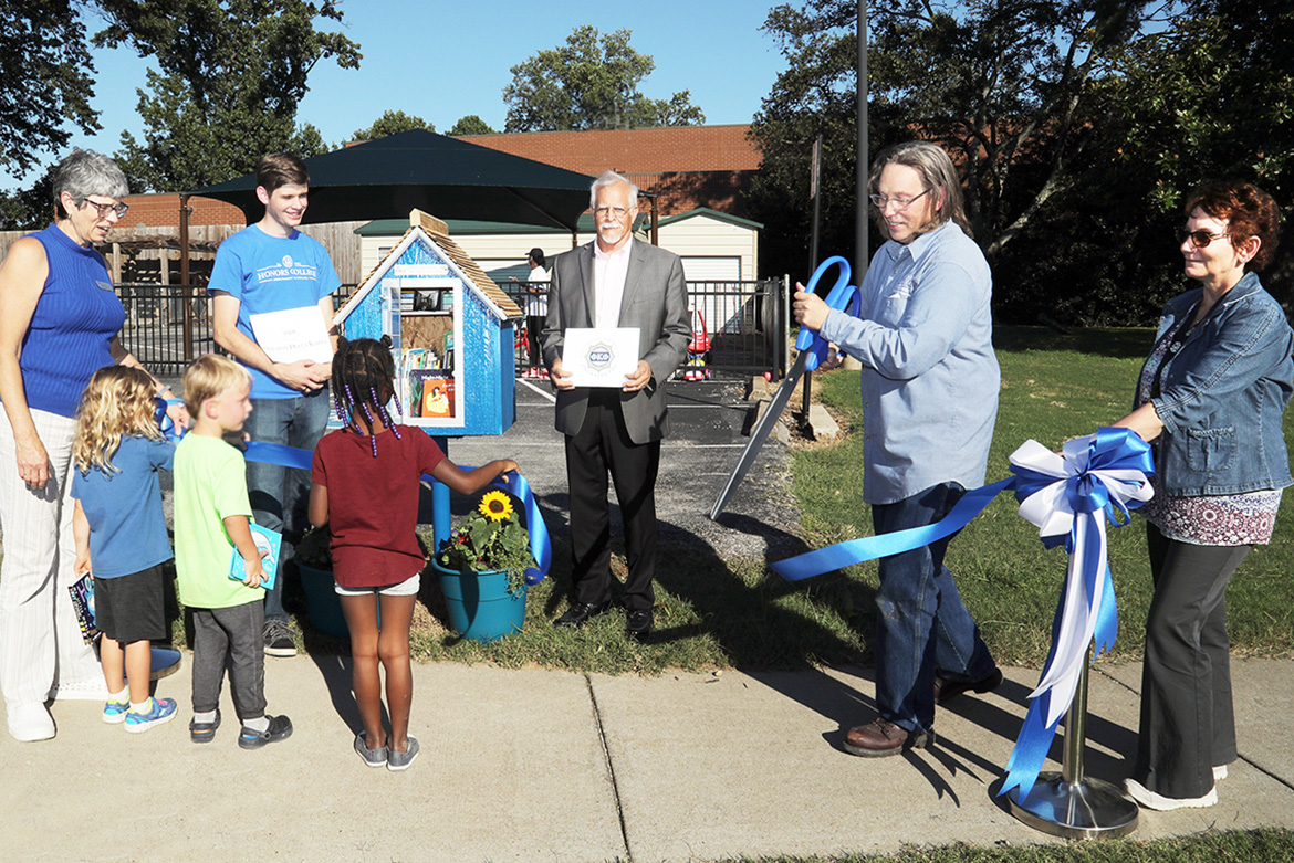Children from the Ann Campbell Early Learning Center located on North Baird Lane observe the ribbon-cutting ceremony for the first Little Free Library placement Sept. 27. Pictured, from left, are Connie Casha, director of Early Learning Programs for the College of Education; Liam McBane, Omicron Delta Kappa chapter president; Dr. David Foote, Phi Kappa Phi Vice President and President-elect and Jennings A. Jones College of Business professor; Nathan Wahl, PKP student vice president; and Sandra Campbell, PKP member and secretary for the Department of Psychology. (MTSU photo by Marsha Powers);