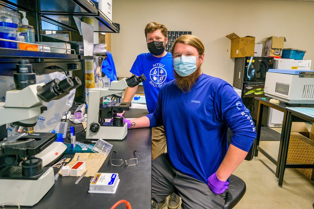 Cole Easson, Middle Tennessee State University research assistant professor, left, works in the lab with MTSU graduate biology student Jeremy Smith in the MTSU Science Building on Sept. 27, 2021. Easson earned a National Science Foundation grant, which funds his marine sponge research project and opens research opportunities for MTSU students. (MTSU photo by Andy Heidt)