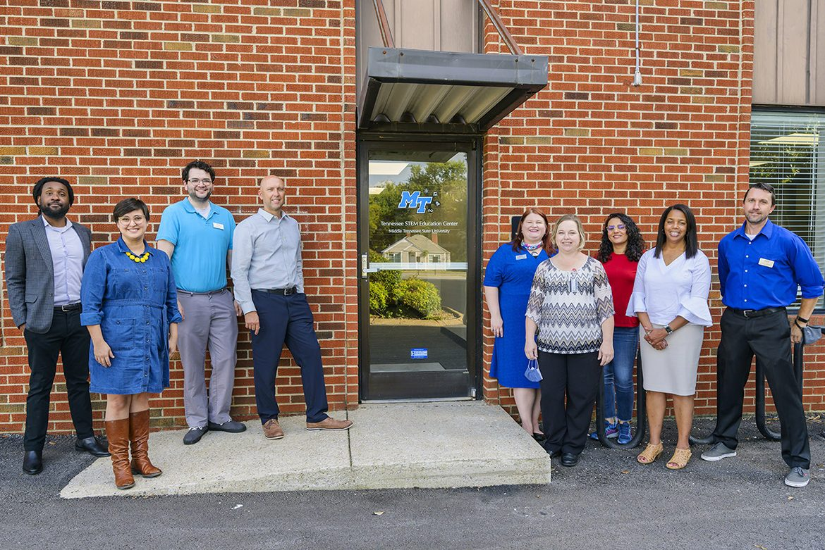 Staff of the Tennessee STEM Education Center at Middle Tennessee State University gather outside their renovated office on campus on Sept. 29, 2021, during their open house event. Standing, from left, are Steven Berryhill, Sarah Gwinn, Josh Reid, Greg Rushton, Mandy Singleton, Sherry Schafer, Shaghayegh Fateh, Andrea Reeder and Grant Gardner. (MTSU photo by Andy Heidt)